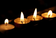 Tea lights burning in memoriam