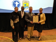 Brett Towler being presented with his U.S. Fish and Wildlife Service award
