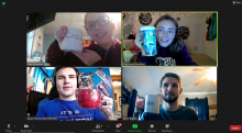 4 students in zoom grid hold up their drink mugs to the camera